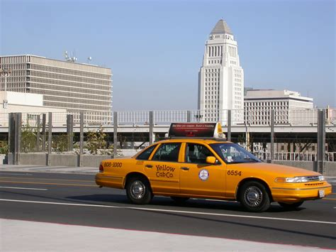 Taxi On Grand Avenue With City Hall In