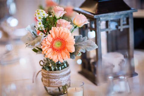 rustic gerbera daisy  rose centerpieces