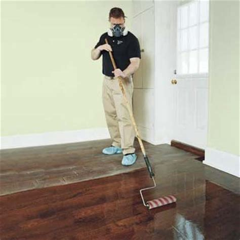 applying polyurethane to hardwood floors roll out the poly how to refinish wood floors this