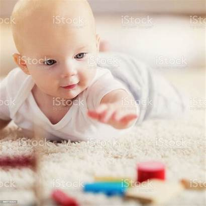 Tummy During Adorable Blocks Wooden Reaches Laying