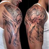 angel-fighting-demon-sleeve-tattoo