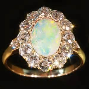 opal vintage engagement rings engagement ring with brilliant cut diamonds and opal afbeeldingen door adin antique
