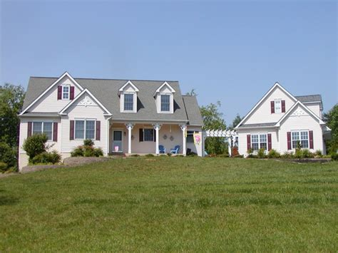 Cape Cod With Detached Garage  Traditional Exterior