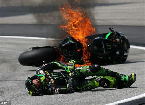 flaming wreck motogp racer pol espargaro thrown  bike