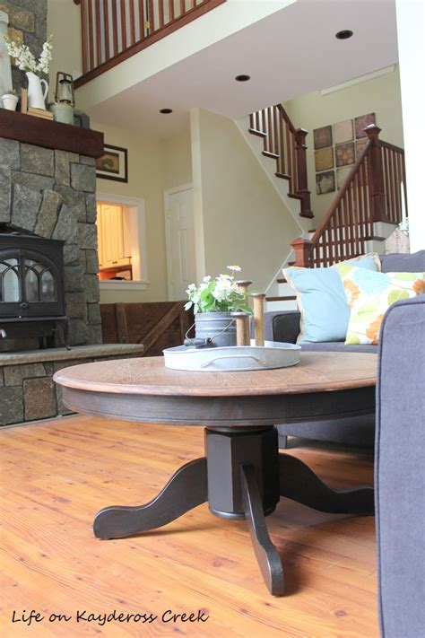 A diy farmhouse coffee table that's giving farmhouse a new name. DIY round farmhouse coffee table - farmhouse vignette - Life on Kaydeross Creek - Life on ...