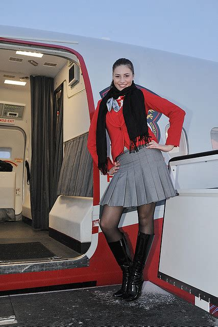 airlines  red wings stewardess   onboard