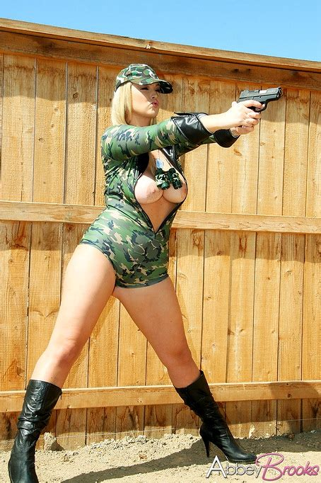 Blonde Military Girl Wielding A Gun And Showing Her Naked