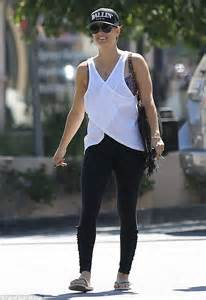 kaley cuoco bares  sculpted arms   white tank top