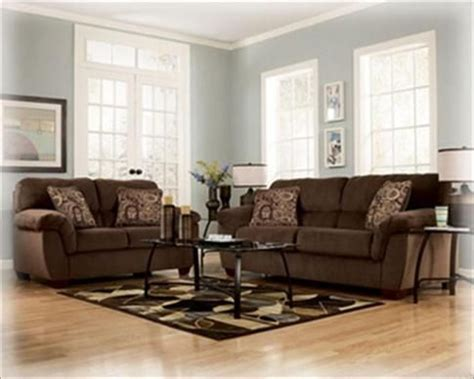 brown couch with pale blue grayish walls brown furniture