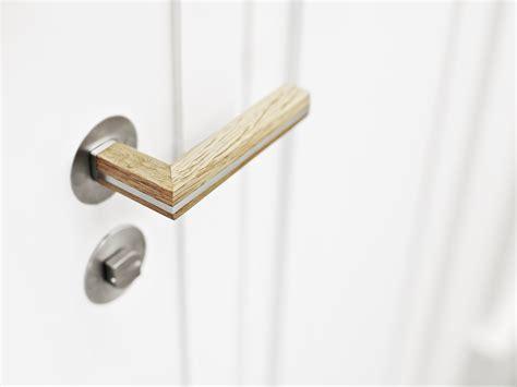 two poign 233 e de porte en acier inoxydable et bois by formani b v design piet boon