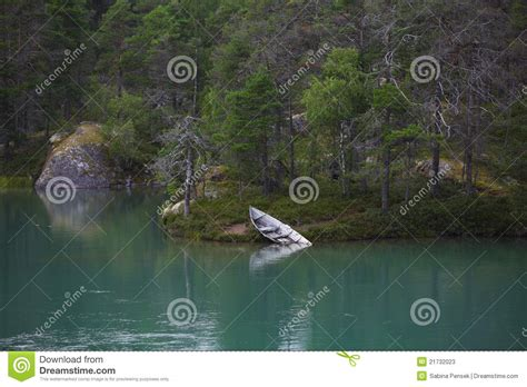 Old Boat Washed Up by Lake With Washed Up Old Boat Stock Image Image 21732023