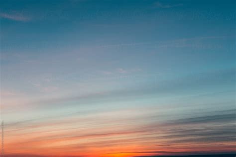 Texture of a sunset sky by Javier Pardina - Stocksy United