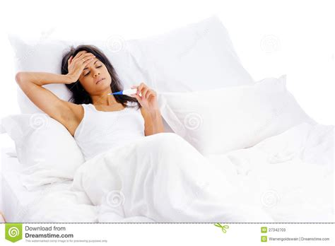 The Girl Is Lying Sick In Bed And Taking Her Temperature