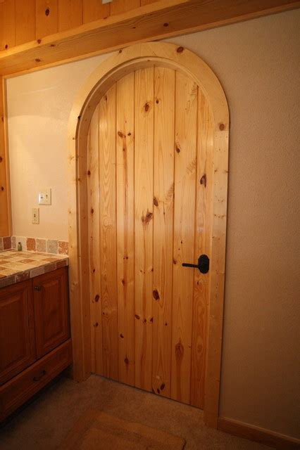 custom arched interior door traditional bathroom