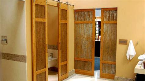 luxury bathroom bamboo barn doors  thatch resin  trustile denver doors wood doors