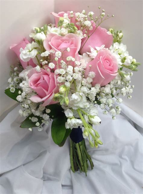 bridal bouquet  pink roses white mini carnations