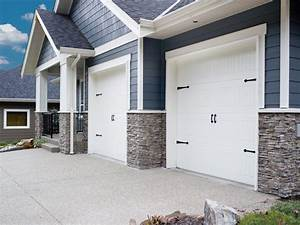 Carriage style garage doors beach style garage for Carriage style garage doors for sale