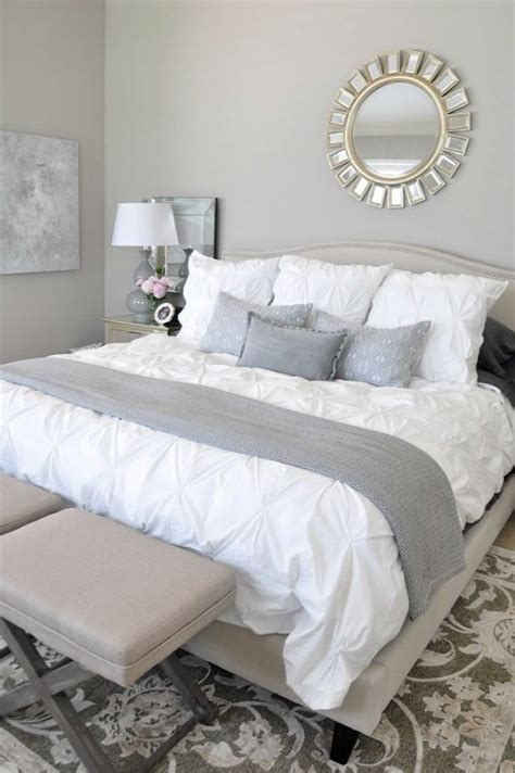 neutral master bedroom, white bedding with neutral rug