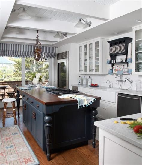 white kitchen island with butcher block top or country home with coffered beadboard ceiling