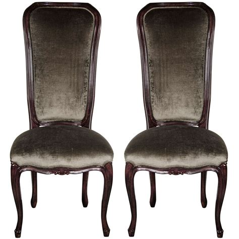 pair of 1940 s high back occasional chairs in