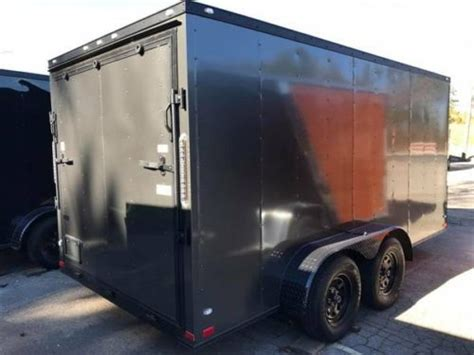 charcoal grey blackout  enclosed motorcycle trailer