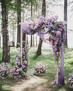 Picture Of a fantastic floral arch with lilac draperies