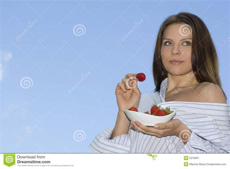 Pretty Girl Relaxing On Balcony And Eat Red Fresh Stock