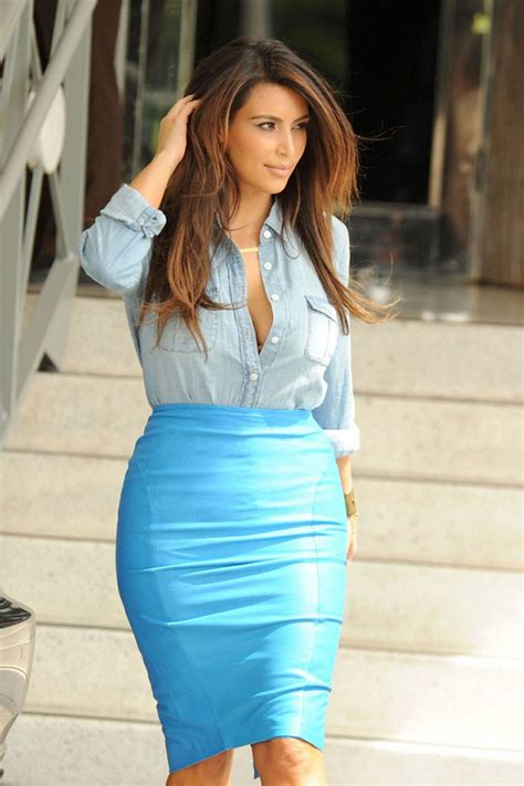 Kim Kardashian flaunts curves in a denim top and pencil ...