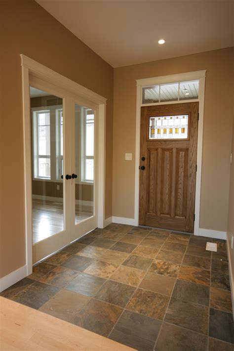 entryway with multi coloured tile that complements door