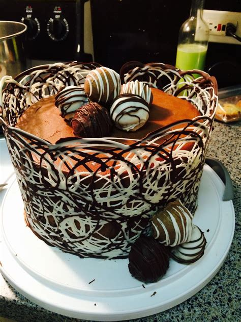 chocolate cake wrapped   piped white  milk