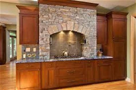 Stacked stone range hood   Kitchens with stone work