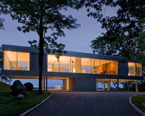 vertical  shaped hilltop house exposes views    sides