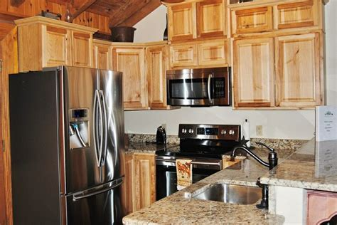 AFTER!  Hickory cabinets, stainless steel appliances