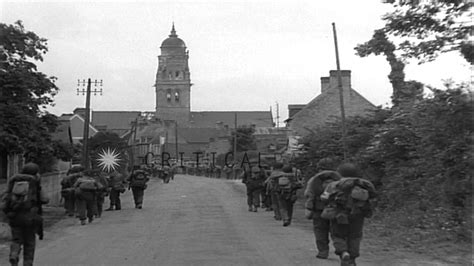 sainte du mont american troops of 1st infantry march into liberated town of st du mont ma hd stock