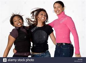 Asian Black and Latino young women laughing and jumping ...