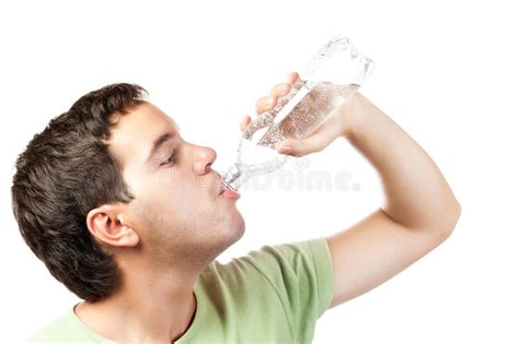 Young Man Drinking Water From Bottle Isolated Royalty Free