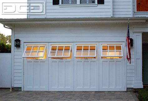 carriage garage doors los angeles real carriage doors with functional awning windows in los