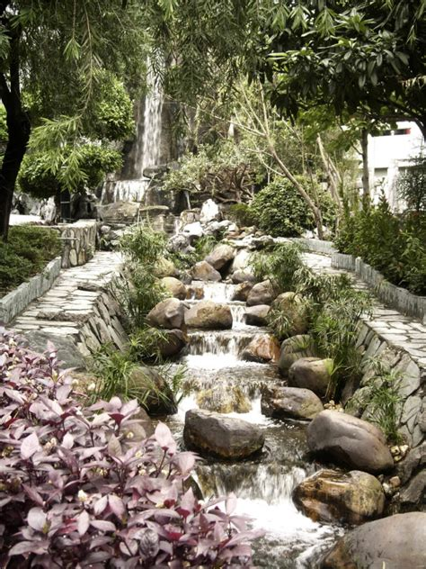 Backyard Waterfalls by Two Narrow Paths Run On Either Side Of This Multi