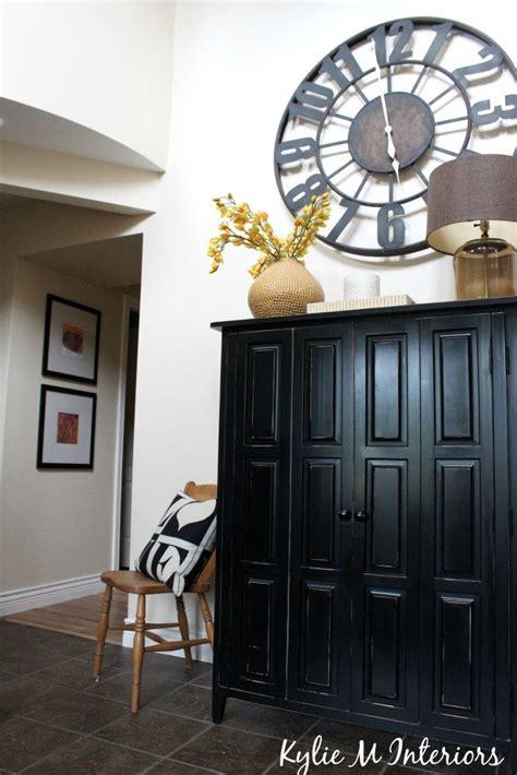 entryway  hallway door removed  large clock black