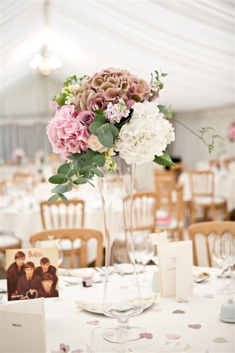 wedding tables tall vases arrangements  belsflowers