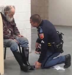 Police Officer Helping Homeless