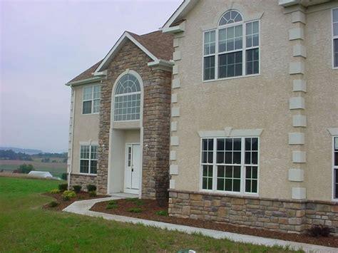 siding cost vs stucco and brick veneer