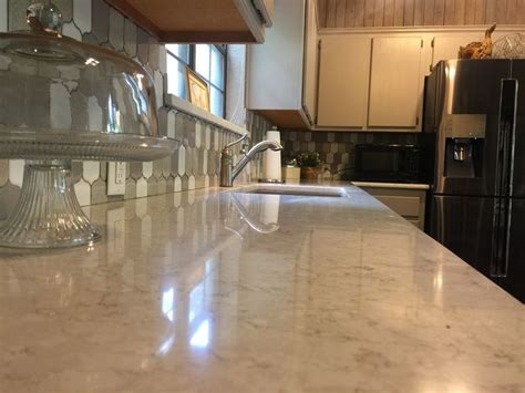lusso quartz countertops  silestone  large single sink   cross  farmhouse