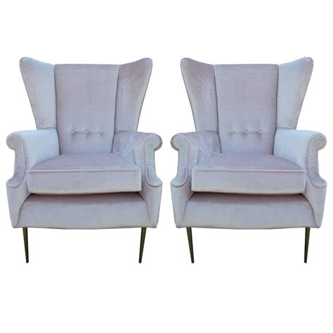 luxe pair of brass legged modern italian wingback chairs