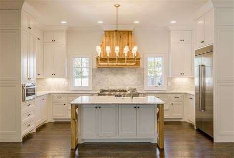 reclaimed wood french kitchen hood  marble cooktop