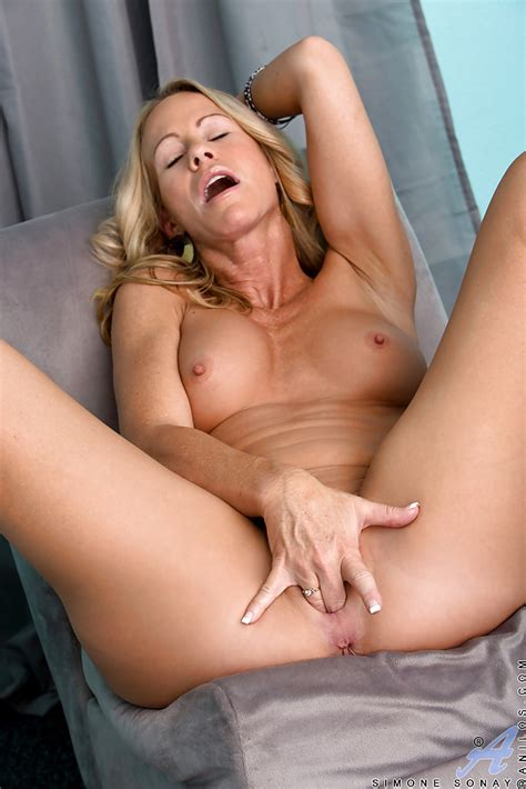 Seductive Mature Blonde Getting Nude And Fingering Her Hungry Pussy