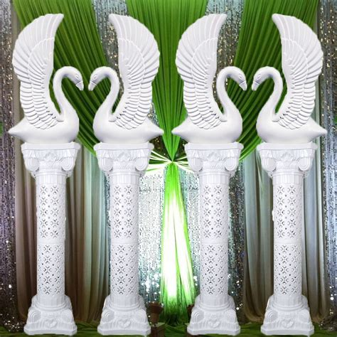 elegant white decorative plastic swans  roman wedding