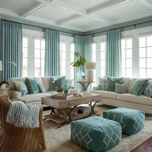 salon avec  mur bleu   televiseur encastre