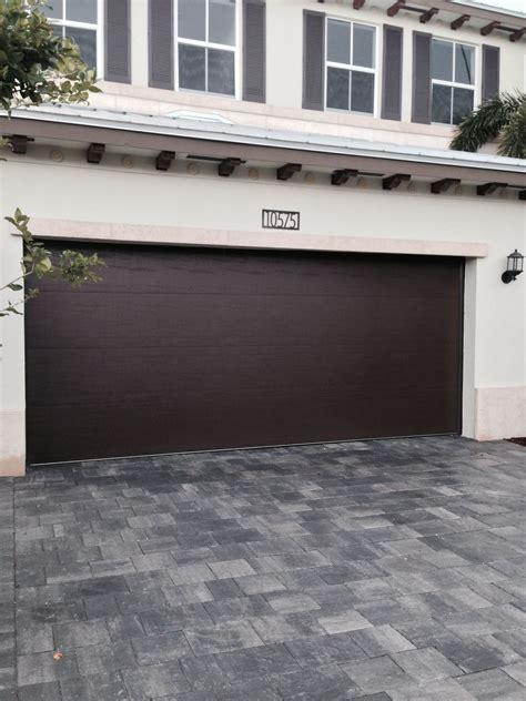 Garage Door Quieter by Clopay Steel Garage Door In A Smooth Panel Design Adds A