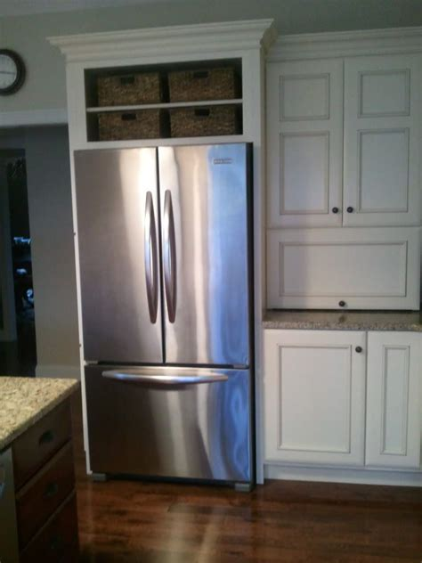 space above kitchen cabinets ideas space above fridge idea i like this or it into a 8184